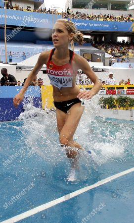 Stock Picture of Germany's Jana Sussmann clears a water jump in a heat of the Women's 3000m Steeplechase at the World Athletics Championships in Daegu, South Korea