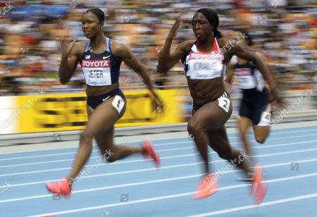 USA's Carmelita Jeter, left, and Britain's Jeanette Kwakye compete in a heat of Women's 100m race at the World Athletics Championships in Daegu, South Korea