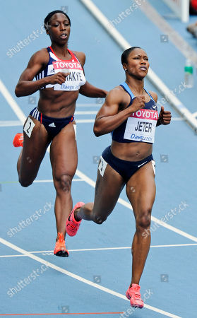 USA's Carmelita Jeter, right, looks at the score board as she crosses the finish line ahead of Britain's Jeanette Kwakye in a heat for the Women's 100m at the World Athletics Championships in Daegu, South Korea