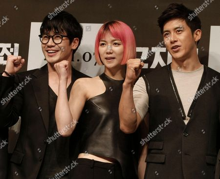 """Shin Ha-kyun, Kim Ok-vin, Ko Soo South Korean actor Shin Ha-kyun, left, actress Kim Ok-vin and Ko Soo pose after a press conference to promote their movie """"The Front Line"""" featuring the Korean War in Seoul, South Korea"""