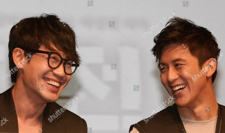 """Shin Ha-kyun, Ko Soo South Korean actor Shin Ha-kyun, left, and Ko Soo smile during a press conference to promote their movie """"The Front Line"""" featuring the Korean War in Seoul, South Korea"""