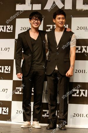 """Stock Picture of Shin Ha-kyun, Ko Soo South Korean actor Shin Ha-kyun, left, and Ko Soo pose after a press conference to promote their movie """"The Front Line"""" featuring the Korean War in Seoul, South Korea"""