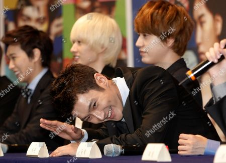 """Siwon, Sungmin, Eunhyuk, Kyuhyun South Korean pop group Super Junior member Siwon reacts during a press conference to promote their new album """"Mr. Simple"""" in Seoul, South Korea, . Other members from left, are Sungmin, Eunhyuk, and Kyuhyun"""