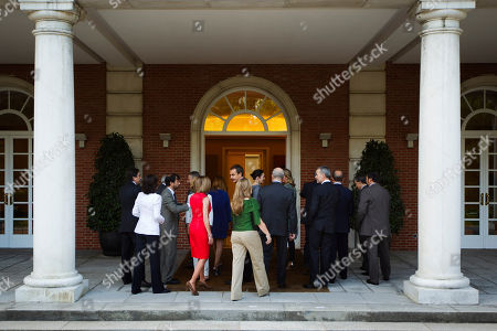 Carme Chacon, Jimenez, Elena Salgado, Jose Luis Rodriguez Zapatero, Manuel Chaves, Francisco Camano, Antonio Camacho, Rosa Aguilar, Valeriano Gomez, Jose Blanco, Angel Gabilondo, Miguel Sebastian, Ramon Jauregui, Leire Pajin, Angeles Gonzalez Sinde, Cristina Garmendia Spain's Prime Minister Jose Luis Rodriguez Zapatero, center, walks inside Moncloa Palce surrounded by his new cabinet ministers during a meeting at the Moncloa Palace, in Madrid, . Investors are easing pressure on Spanish markets in reaction to the European Union's new deal to help Greece with another bailout. After days of negative trading Madrid's stock exchange climbed 2 percent just 15 minutes after opening Friday