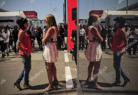 Stock Image of Raquel del Rosario, Fernando Alonso Spanish singer Raquel del Rosario, left, the wife of Spanish Ferrari's Fernando Alonso, reflects on a glasses before to starting Spanish Grand Prix race track at Montmelo, in Montmelo, Spain