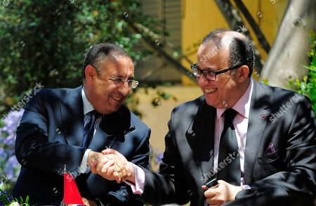 The new Secretary General of The Union for the Mediterranean (UfM) Moroccan Youssef Amrani, left, shakes hands with Moroccan Minister of Foreing Affairs Taib Fassi Fihri during his official take office ceremony in Barcelona, Spain