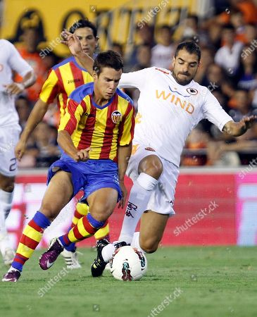 Juan Bernat, Simone Perrotta Valencia's Juan Bernat, left duels for the ball with AS Roma's Simone Perrotta during their Naranja Trophy friendly soccer match at the Mestalla stadium in Valencia, Spain