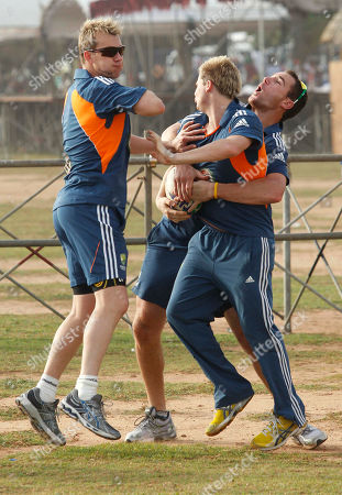 Stock Image of Brett Lee, Steve Smith, John Davison Australian T20 cricket team members Brett Lee, from left, Steve Smith and John Davison share a light moment during a training session at Galle Face Green, a public sea promenade in Colombo, Sri Lanka, . Sri Lanka and Australia play two T20 matches, on Aug. 6 and 8 prior to the One Day International (ODI) series which begins on Aug. 10, followed by a test series beginning Aug. 31