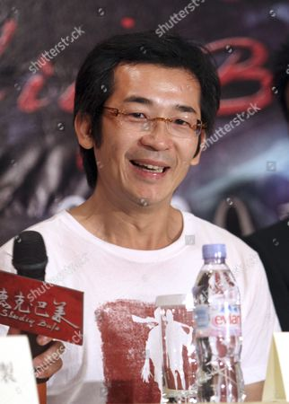 """Wei Te-Sheng Taiwanese director Wei Te-Sheng poses for photographers during a media conference announcing his latest movie """"Seediq Bale"""" in Taipei, Taiwan, . The """"Seediq Bale,"""" an Taiwanese historical drama film, has been selected as one of the films in competition at the 68th Venice International Film Festival and will show there on Sept. 1"""