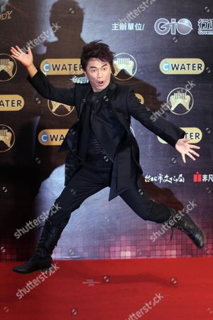 Jacky Wu Taiwanese host Jacky Wu jumps upon arrival for the 22nd Golden Melody Awards in Taipei, Taiwan