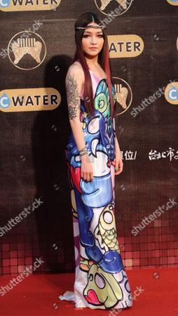 Stock Photo of Mavis Fan Taiwanese pop singer Mavis Fan poses upon arrives for the 22nd Golden Melody Awards in Taipei, Taiwan
