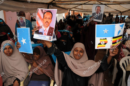 Somali refugees holding posters of Somali Prime Minister, Mohamed Abdullah Mohamed, in Uganda Kampala demonstrate in support of the extension of Transitional Federal Government of Somalia . They urged the Prime Minister to cooperate with President Sheik Sharif Ahmed, to consolidate peace attained by AU troops in Somalia. Mohamed is opposed to the extension of the government and is calling for elections. Sharif says his security forces will defeat al Qaeda and its affiliate militants in the war-ravaged country after they killed Fazul Abdullah Mohammed, Africa's most wanted al Qaeda operative, last week