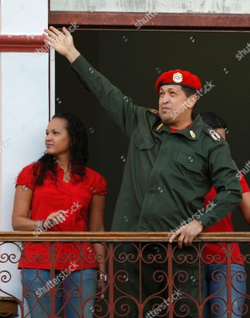 Hugo Chavez, Rosa Virginia Chavez Venezuela's President Hugo Chavez greets supporters from a balcony of Miraflores presidential palace next to his daughter Rosa Virginia in Caracas, Venezuela, . Chavez returned to Venezuela from Cuba on Monday morning, stepping off a plane hours before dawn and saying he is feeling better as he recovers from surgery that removed a cancerous tumor