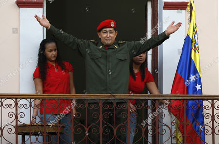 Hugo Chavez, Maria Gabriela Chavez, Rosa Virginia Chavez Venezuela's President Hugo Chavez greets supporters next to his two daughters: Rosa Virginia, left, and Maria Gabriela at a balcony of the Miraflores presidential palace in Caracas, Venezuela, . Chavez returned to Venezuela from Cuba on Monday morning, stepping off a plane hours before dawn and saying he is feeling better as he recovers from surgery that removed a cancerous tumor