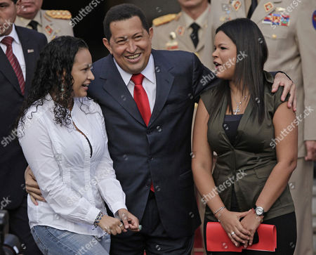 Hugo Chavez, Rosa Virginia Chavez, Gabriela Chavez Venezuela's President Hugo Chavez, flanked by his daughters Rosa Virginia, right, and Gabriela, gestures after he announced he will return to Cuba Saturday to begin a new phase of cancer treatment that will include chemotherapy at Miraflores presidential palace in Caracas, Venezuela