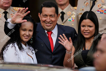 Hugo Chavez, Rosa Virginia Chavez, Gabriela Chavez Venezuela's President Hugo Chavez, waves flanked by his daughters Rosa Virginia, right, and Gabriela, after he announced he will return to Cuba Saturday to begin a new phase of cancer treatment that will include chemotherapy at Miraflores presidential palace in Caracas, Venezuela