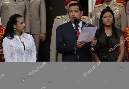 Hugo Chavez, Rosa Virginia Chavez, Gabriela Chavez Venezuelan President Hugo Chavez, flanked by his daughters Rosa Virginia, right, and Gabriela, gestures after he announced he will return to Cuba Saturday to begin a new phase of cancer treatment that will include chemotherapy at Miraflores presidential palace in Caracas, Venezuela