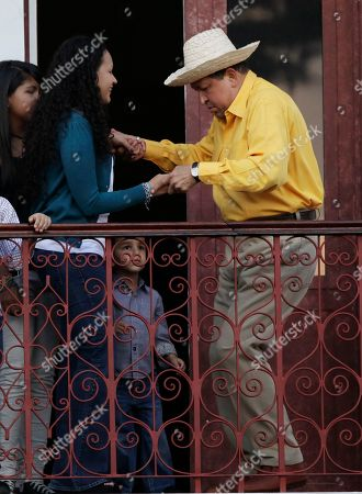 Hugo Chavez, Rosa Virginia Chavez Venezuela's President Hugo Chavez, left, dances with his daughter Rosa Virginia at a balcony of Miraflores presidential palace in Caracas, Venezuela, . Chavez sang on a balcony of the presidential palace as he celebrated his 57th birthday before a crowd of adoring supporters, vowing to overcome cancer