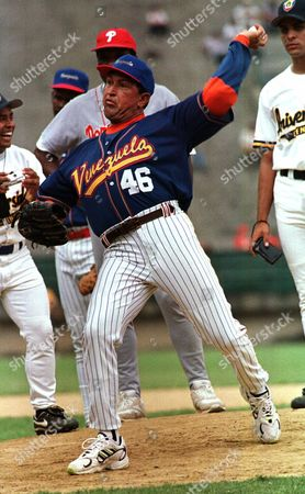 Hugo Chavez Venezuela's President Hugo Chavez, wearing the national baseball team uniform, pitches to Chicago Cubs out fielder Sammy Sosa during a batting exhibition at Universtity Stadium in Caracas, Venezuela. Venezuela's Vice President Nicolas Maduro announced on that Chavez has died. Chavez, 58, was first diagnosed with cancer in June 2011