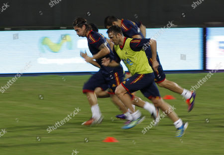 Spain's Sergio Ramos, left, and teammate Carlos Marchena run during a training session in Puerto La Cruz, Venezuela, . Spain will face Venezuela in a friendly soccer game on Tuesday