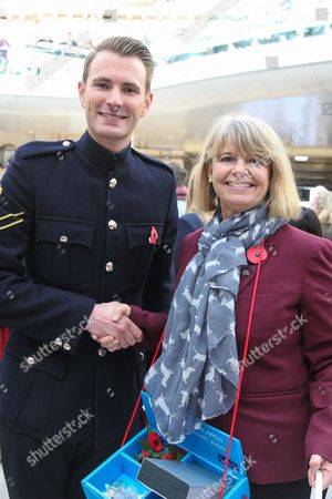 Harriett Baldwin MP Parliamentary Under Secretary of State and Minister for Defence Procurement and Magician Lance Corporal Richard Jones