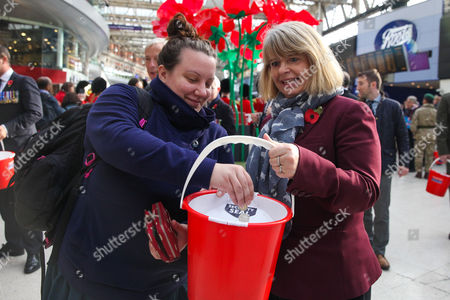 Harriett Baldwin MP Parliamentary Under Secretary of State selling poppies to commuters
