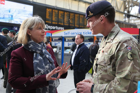 Harriett Baldwin MP Parliamentary Under Secretary of State with a member of the Army