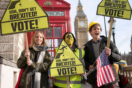 Demonstrators, from left, Celeste Allen, 27, from New York, Jennypher Calderon, from Colombia, and David Christensen, from California, hold placards calling on Americans to vote and avoid getting 'Brexited' in the U.S. presidential election at a demonstration organized by global civic movement AVAAZ, at Parliament Square, in London
