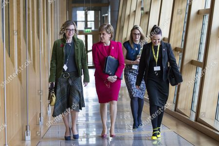 Gillian Martin, Nicola Sturgeon, First Minister of Scotland and Leader of the Scottish National Party (SNP), and Gail Ross make their way to the Debating Chamber