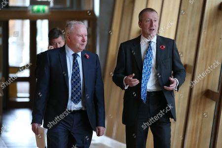 Alex Neil and Tavish Scott make their way to the Debating Chamber