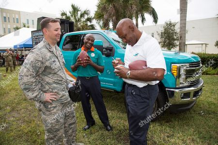 Ford Hits the Gridiron with NFL Tailgate Experience - Base Visit OJ McDuffie and Dwight Stephenson talking with an Air Force Major member assigned to US Southern Command at the Built Ford Tough Toughest Tailgate on in Doral, Fla