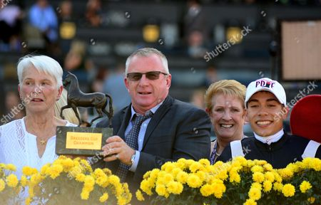 SANTA ANITA. Breeders Cup Juvenile Turf. OSCAR PERFORMANCE won for trainer Brian Lynch, with trophy and jockey JOSE ORTIZ.