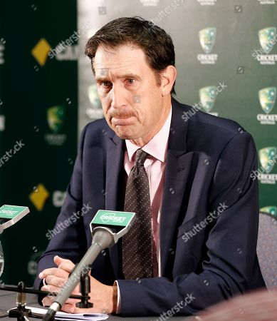 """Cricket Australia CEO James Sutherland listens to questions during a press conference after New South Wales state coroner Michael Barnes handed down his findings for the Hughes inquest in Perth, Australia, . A coroner has found that a """"minuscule misjudgment"""" by Phillip Hughes while facing a steeply bouncing cricket ball resulted in the fatal blow to his head during an Australian domestic first-class match in November 2014. Barnes made four key recommendations, including directions to Cricket Australia to review its dangerous and unfair bowling regulations to reduce any inconsistencies in interpretation by umpires, and to identify a helmet neck protector and make it mandatory for batsmen in first-class matches"""