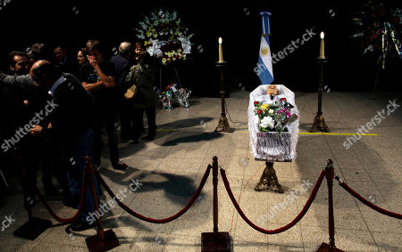 People mourn next to the coffin containing the body of Argentine writer Ernesto Sabato during his wake in Buenos Aires, Argentina, . Sabato, who led the government's probe of crimes committed by Argentina's dictatorship, died at 99 of complications of bronchitis, his friend and collaborator Elvira Gonzalez Fraga told local media