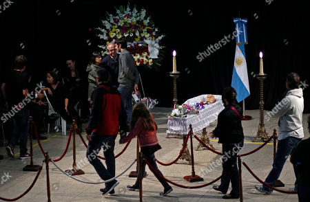 People attend the wake of Argentine writer Ernesto Sabato in Buenos Aires, Argentina, . Sabato, who led the government's probe of crimes committed by Argentina's dictatorship, died at 99 of complications of bronchitis, his friend and collaborator Elvira Gonzalez Fraga told local media