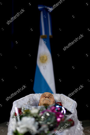 The body of Argentine writer Ernesto Sabato sits in a coffin during his wake in Buenos Aires, Argentina, . Sabato, who led the government's probe of crimes committed by Argentina's dictatorship, died at 99 of complications of bronchitis, his friend and collaborator Elvira Gonzalez Fraga told local media