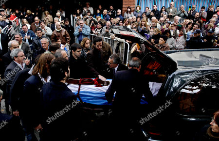 Relatives of Argentine author Ernesto Sabato carry his remains to a hearse during his funeral in Buenos Aires, Argentina, . Sabato, who led the government's probe of crimes committed by Argentina's dictatorship, died early Saturday in his home. He was 99