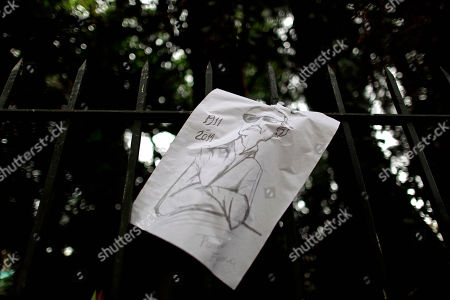 A drawing depicting the late Argentine author Ernesto Sabato hangs on the gate of his home on the outskirts of Buenos Aires, Argentina, . Sabato, who led the government's probe of crimes committed by Argentina's dictatorship, died early Saturday in his home. He was 99
