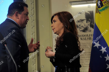 Hugo Chavez, Cristina Fernandez Venezuela's President Hugo Chavez, left, and Argentina's President Cristina Fernandez speak in front of an image of late journalist Rodolfo Walsh during a meeting at the government house in Buenos Aires, . The University of La Plata is giving Chavez its Rodolfo Walsh Prize on Tuesday for what it describes as his work giving people without a voice access to the airwaves and newspapers