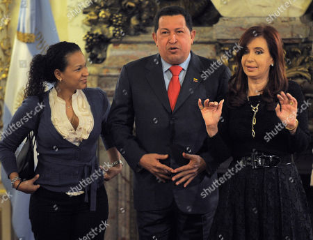 Hugo Chavez, Cristina Fernandez, Rosa Virginia Chavez Venezuela's President Hugo Chavez, center, accompanied by his daughter Rosa Virginia Chavez, left, looks on as Argentina's President Cristina Fernandez gestures during a meeting at the government house in Buenos Aires, . Chavez is on a one-day official visit to Argentina