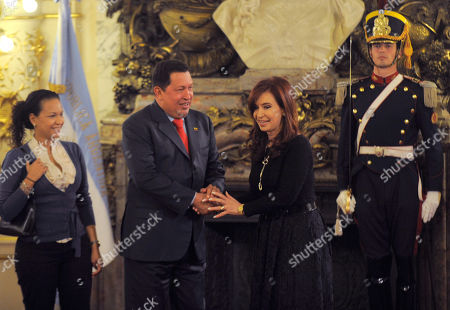 Hugo Chavez, Cristina Fernandez, Rosa Virginia Chavez Venezuela's President Hugo Chavez, center, accompanied by his daughter Rosa Virginia Chavez, left, shakes hands with Argentina's President Cristina Fernandez during a meeting at the government house in Buenos Aires, . Chavez is on a one-day official visit to Argentina