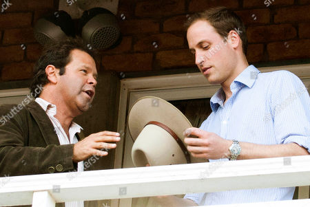 William, Troy Cassar-Daley Britain's Prince William, right, accepts an Akubra hat from Australian country singer Troy Cassar-Daley while attending a spirit of the country concert at Toowooba, Australia