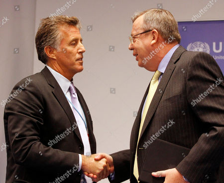 Yury Fedotov, Christopher Kennedy Lawford Executive Director from United Nations Office on Drugs and Crime, UNODC, Yury Fedotov, right, shakes hands with U.S. actor Christopher Kennedy Lawford as goodwill ambassador on drug dependence treatment and care at the International Center, in Vienna, Austria, on