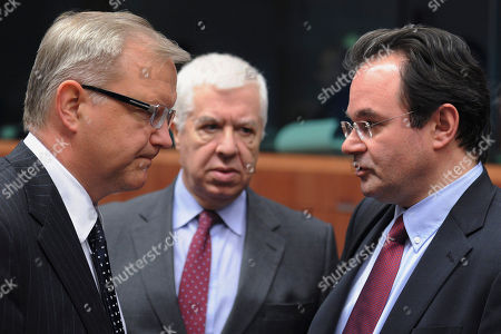 Stock Picture of Olli Rehn, Fernando Teixeira dos Santos, George Papaconstantinou EU Commissioner for Economic and Monetary Affairs Olli Rehn, left, talks with Greece's Finance Minister George Papaconstantinou, right, and Portugal's Finance Minister Fernando Teixeira dos Santos at the start of an Eurogroup meeting at the EU Council in Brussels, . European finance ministers are meeting over the coming two days in Brussels, with Portugal and Greece topping the agenda