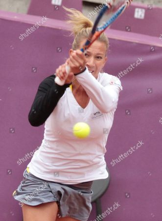 Marta Domachowska Poland's Marta Domachowska returns the ball towards Estonia's Kaia Kanepi, during the first round of the Brussels Open tennis tournament in Brussels