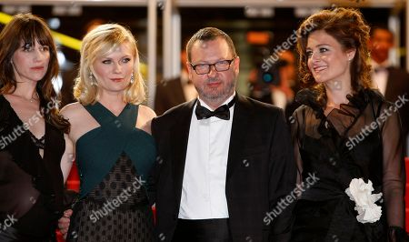 """Charlotte Gainsbourg, Kirsten Dunst, Lars Von Trier, Bente Froge Actresses Charlotte Gainsbourg, Kirsten Dunst, director Lars Von Trier and his wife Bente Froge arrive for the screening of Melancholia at the 64th international film festival, in Cannes, southern France. Danish filmmaker Lars Von Trier has been labeled """"persona non grata"""" at Cannes by the organizers regarding comments made a day earlier. It was not immediately known if the film Melancholia would no longer be eligible for prizes"""
