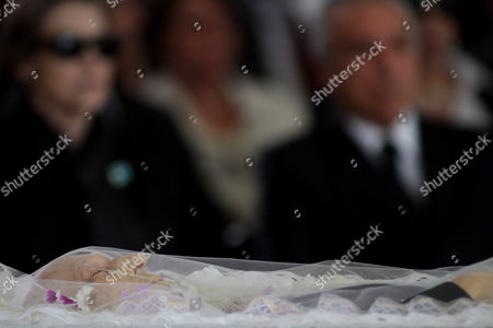 The body of Brazil's former Vice President Jose Alencar lies during his wake as his wife Mariza Alencar, left, and Brazil's Vice President Michel Temer look on at the Planalto Palace in Brasilia, Brazil, . Alencar, who served two terms under President Luiz Inacio Lula da Silva, died Tuesday afternoon in a Sao Paulo hospital after fighting abdominal cancer since 1997. He was 79
