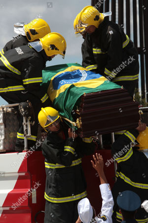 Military firefighters carry the coffin carrying the remains of Brazil's former Vice President Jose Alencar as they arrive to Planalto Palace in Brasilia, Brazil, . Alencar, who served two terms under President Luiz Inacio Lula da Silva, died Tuesday afternoon in a Sao Paulo hospital after fighting abdominal cancer since 1997. He was 79