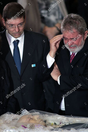 Luiz Inacio Lula da Silva, Josue Alencar Brazil's former President Luiz Inacio Lula da Silva, right, mourns over the body of Brazil's former Vice President Jose Alencar during a tribute at the Planalto palace in Brasilia, Brazil, . Alencar, who served two terms under Lula da Silva, died Tuesday afternoon in a Sao Paulo hospital after fighting abdominal cancer since 1997. He was 79. Josue Alencar, son of the former vice president, is pictured at left