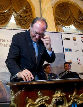 Stock Picture of Ramon Pont Ramon Pont, vice president of the Barcelona futbol club foundation signs a document during a launching event in Rio de Janeiro, Brazil, . FC Barcelona and the Inter-American Development Bank, IBD, launched a sports' social project for underprivileged children in partnership with the U.S. National Basketball Association, company of advertising and marketing WPP and the city of Rio de Janeiro. In background are, from right, Brazilian former soccer player Ronaldo and Luis Alberto Moreno, president of the Inter-American Development Bank, IBD